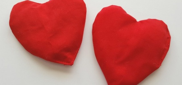 Make heart shaped bean bags for kids games and activities and add them to a Valentine theme - Preschool Toolkit