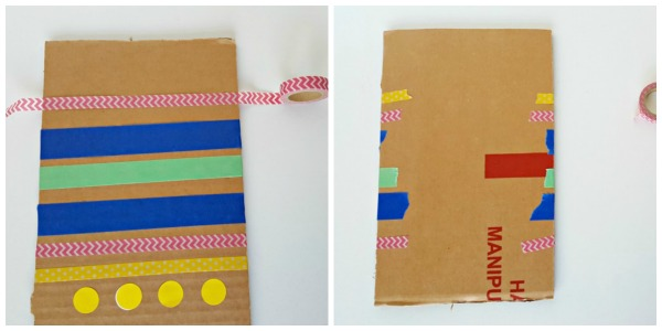 Wrap loose ends of masking tape to the back of the cardboard canvas