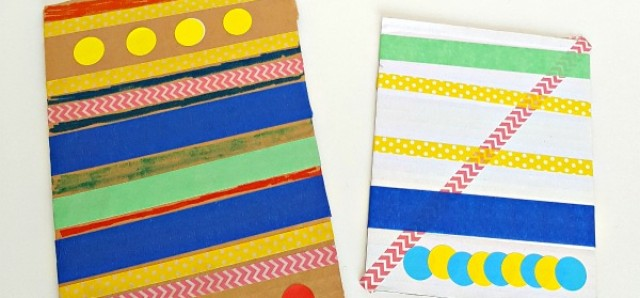 Kids art with crayons and tape on cardboard canvas for creative and fine motor play