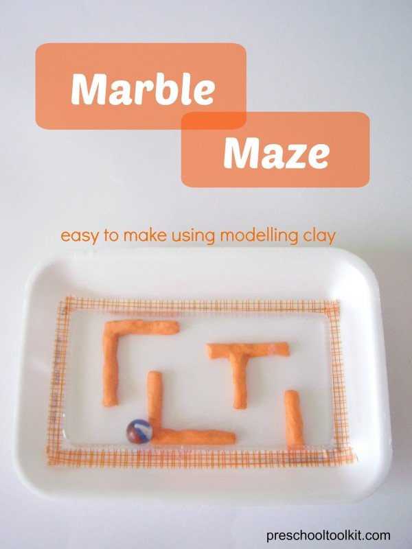 Marble maze activity with modeling clay and recycled foam tray