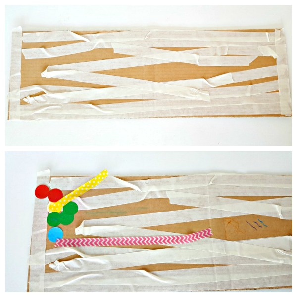 Masking tape and crayons artwork on a cardboard canvas