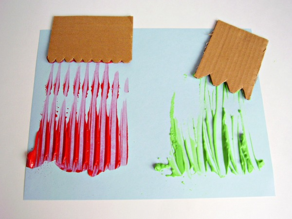 spread paint with cardboard spreaders for preschool process art