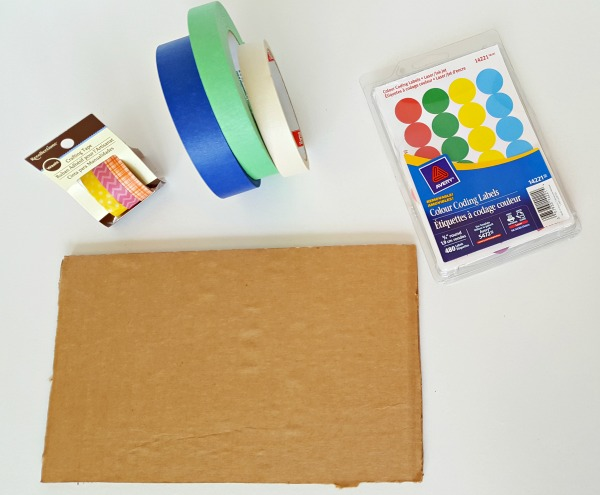 Supplies for preschool artwork activity include tape and dots