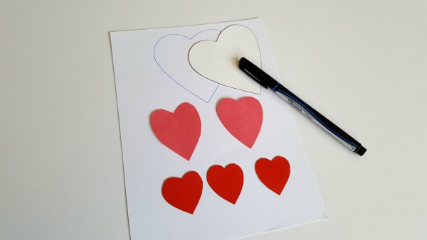 Heart cut outs to decorate containers for bean bag game