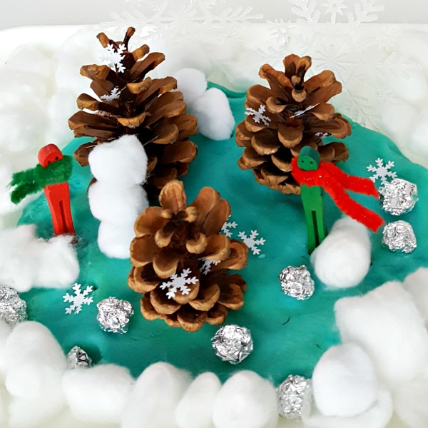 Kids small world forest winter craft and activity with pine cones