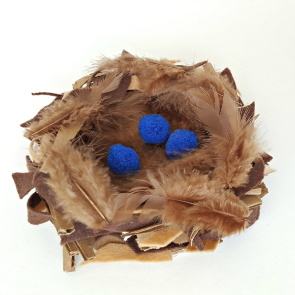 Bird nest preschool craft with feathers and felt