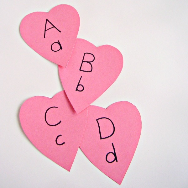 Letters of the alphabet heart shape cards for a Valentine literacy activity